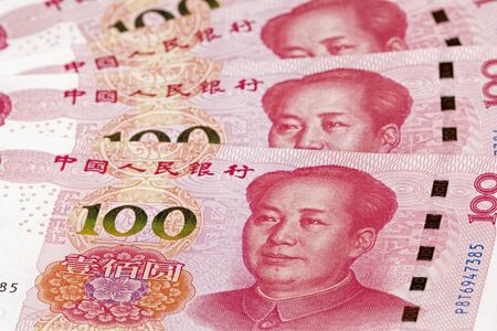 Collage of New Chinese 100 RMB or Yuan featuring Chairman Mao on the front of each bill