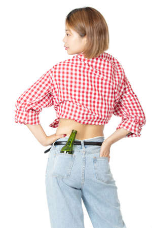 Beautiful Chinese American woman with a bottle of beer in her hip pocket isolated on white background Stock fotó