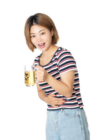 Beaufiful Chinese American woman holding a mug of beer isolated on white background