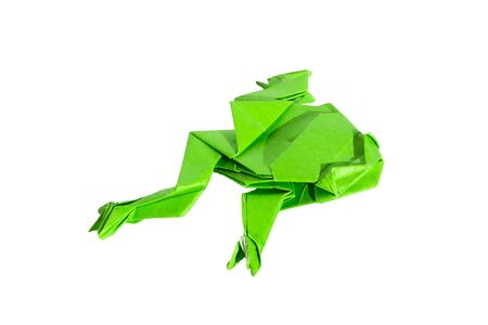 Green origami frog isolated on white.the frog is made of origami paper. photo