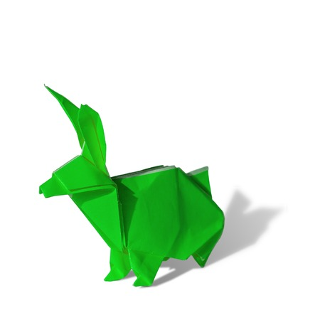 pointy: Origami rabbit made of colored paper. the rabbit is standing on a white surface and casts shadow.  It has long pointy ears. Stock Photo