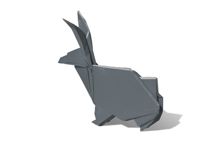 pointy: Gray Origami rabbit made of colored paper. the rabbit is standing on a white surface and casts shadow.  It has long pointy ears.