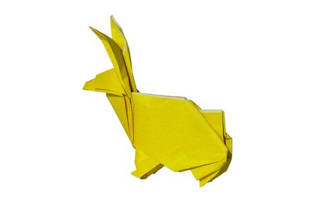 pointy ears: Origami rabbit made of colored paper. the rabbit is standing on a white surface and casts shadow.It has long pointy ears.