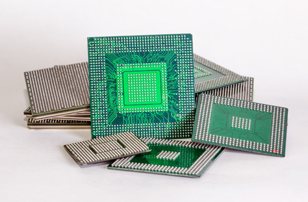 electronic chips isolated on white background. The chips are of different colors shapes and sizes. photo