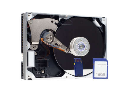 mass storage: Picture showing computer harddrive and SD card comapred in size. Isolated on white.