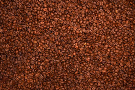 Background of roasted coffee beens. Texture of brown coffee beens.