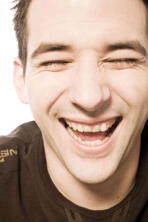 laughing out loud: Boy re�r a carcajadas mientras se mira a la c�mara  Foto de archivo