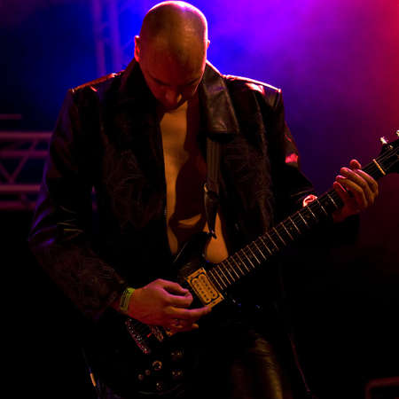 instrumentalist: Photos made at a live concert of a rock and metal band Stock Photo