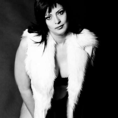 30 34 years: Beauty adult woman portraits taken in the studio. This fur is synthetic.