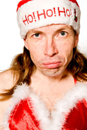 studioshot: Funny portrait of a man with a christmas hat and a christmas bikini.