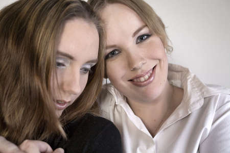 Studio portrait of two lesbian women holding each other Stock Photo