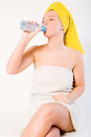 Studio portrait of a spa girl drinking Stock Photo - 2329353