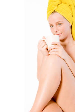 Studio portrait of a spa girl drinking coffee with her leg up Stock Photo - 2329305