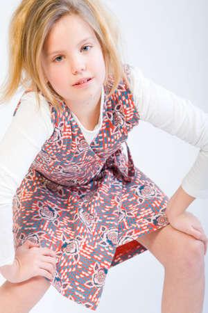 Studio portrait of a blond child posing fashion style