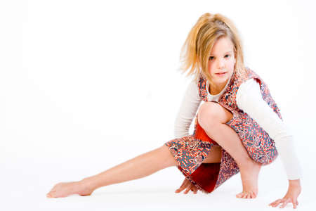 Studio portrait of a blond child stretching photo