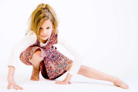 Studio portrait of a blond child stretching photo
