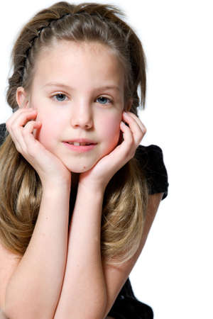 Studio portrait of a blond young interested girl Stock Photo