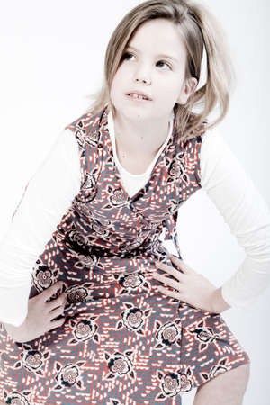 fashionably: Studio portrait of a blond child looking up fashionably