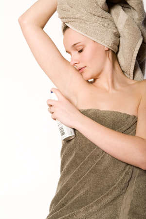 Young woman in towel on a white background grooming Stock Photo