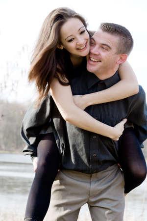 Young man lifting up his beautiful girlfriend