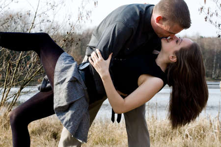 Young loving couple are hugging in the park