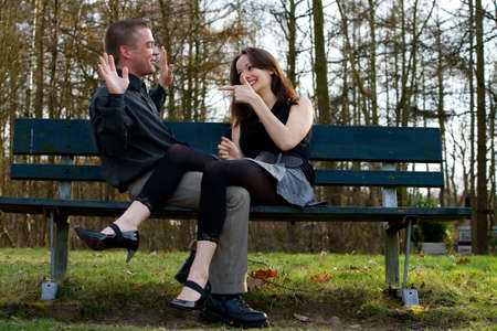 Man and girlfriend on a bench in a park having fun Stock Photo - 2641268
