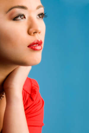 Young chinese girl on a blue background Stock Photo - 2706249