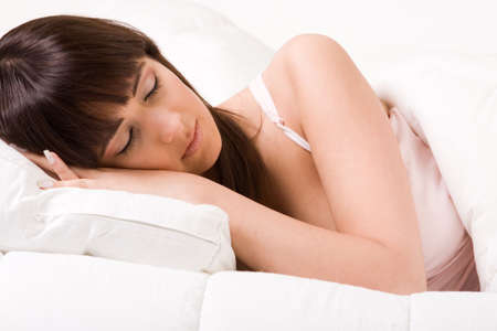 Cute girl in bed hugging her pillow Stock Photo - 2756454