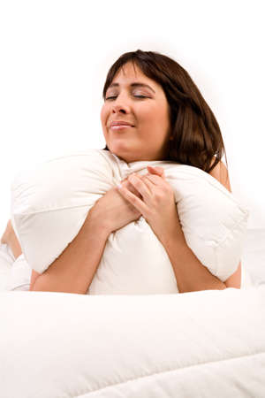 Cute girl in bed hugging her pillow Stock Photo - 2756263