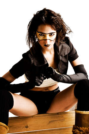agressive: Young brunette looking agressive with extreme face paint