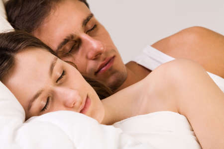 sexy woman on bed: Young adult couple in the studio sleeping