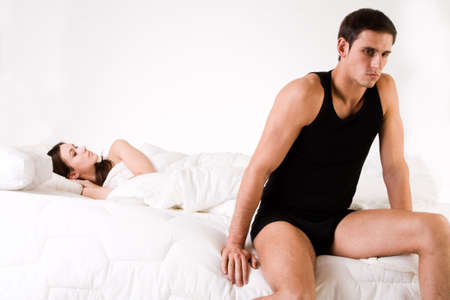 boy underwear: Young adult couple in the studio on a bed