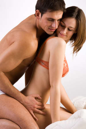 Young adult couple in the studio enjoying photo
