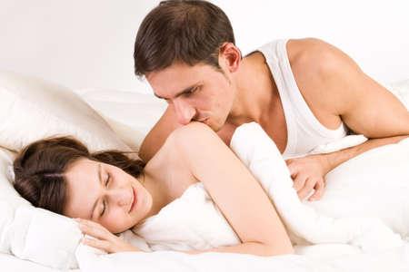 Young adult couple in the studio sleeping photo