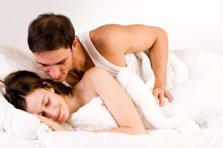 Young adult couple in the studio waking up photo