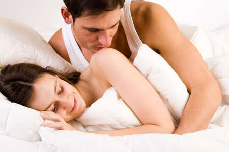 Young adult couple in the studio waking up Stock Photo