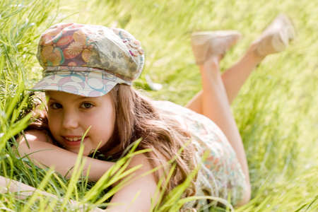 Young girl is laying down in the grass Stock Photo - 3034976