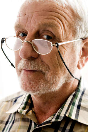 portrait of an elderly man with reading glasses