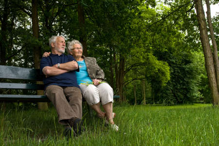 Outside portrait of an elderly couple on a bench Stock Photo
