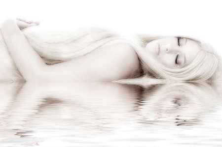 Beautiful blond model in the studio lying down like a princess Stock Photo - 3266129