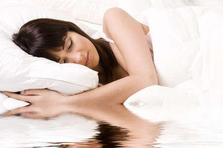 Brunette in bed sleeping