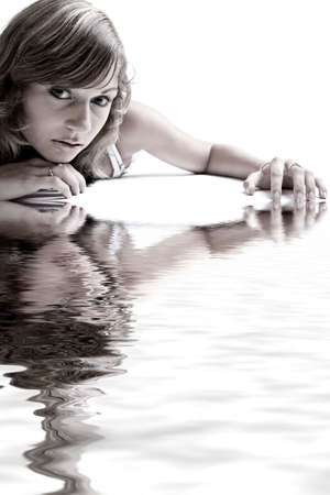 Studio portrait of a teenage model on the floor photo