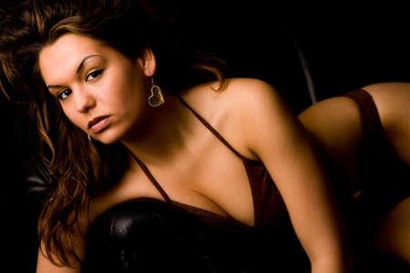 Fresh brunette girl in lingerie on a bench