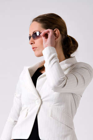 sturdy: Young sturdy woman with sunglasses on a white background