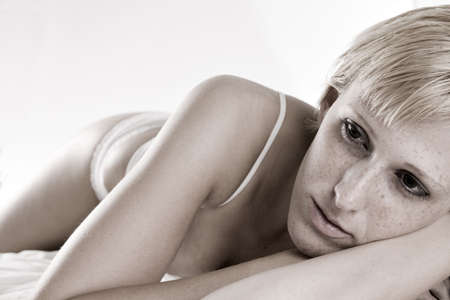 Studio portrait of a blond short haired girl in lingerie looking bored Stock Photo - 3402575