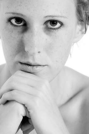 about you: Studio portrait of a short haired blond girl thinking about you Stock Photo