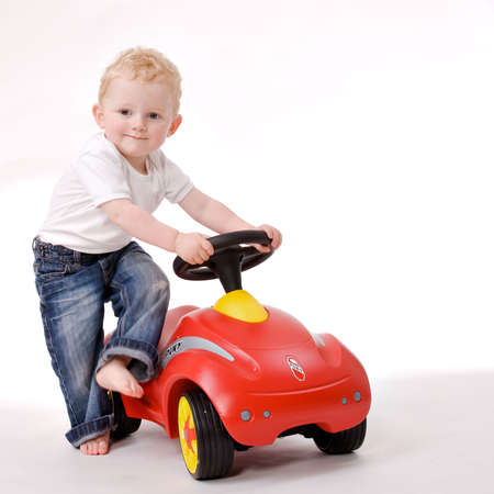 Cute caucasian blond toddler ishappy and playfull Stock Photo