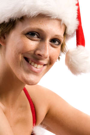 Studio portrait of blond christmas girl smiling at you photo