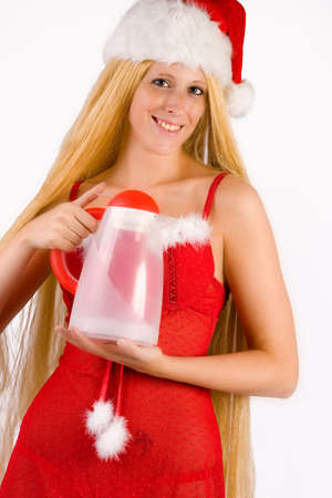 Studio portrait of blond christmas girl with very long blond hair photo