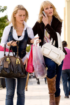Two young girls shopping in the sunny weather